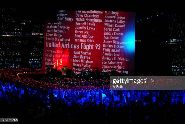 A banner displays names of victims of the september 11 attacks during a performance by the band U2 during the halftime show of Superbowl XXXVI at the...