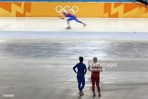 A competitor is watched as she speeds round the track in the Women's 1500m Speed Skating event at the Utah Olympic Oval during the Salt Lake City...