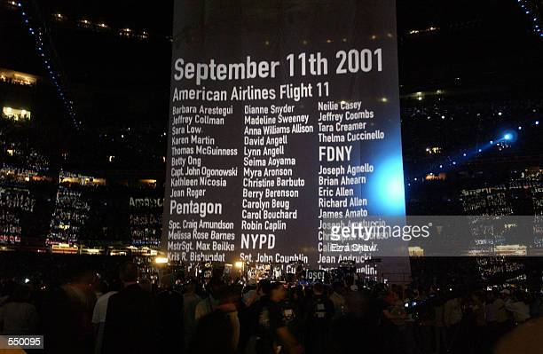A giant banner displays names of victims of the september 11 attacks during a performance by the band U2 during the halftime show of Superbowl XXXVI...