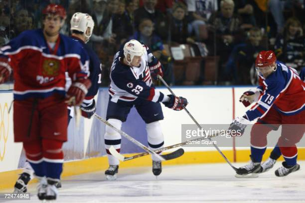 Aaron Miller of the USA and Alexei Yashin of Russia try to gain control of the puck during the Salt Lake City Winter Olympic Games at the E Center in...