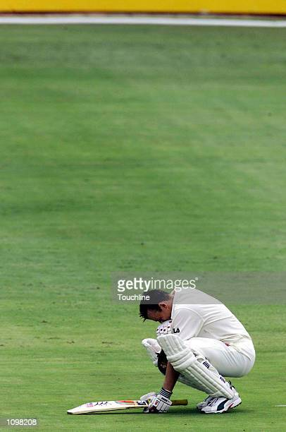 Adam Gilchrist of Australia has a moment to himself after reaching his century during the second day of the first test between South Africa and...