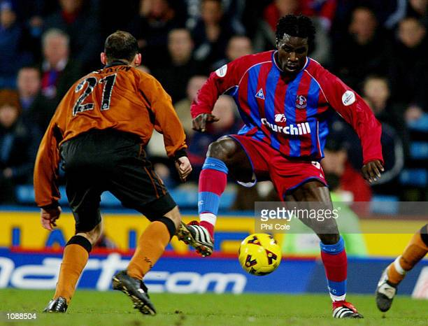 Ade Akinbiyi of Palace takes on Colin Cameron of Wolves during the Nationwide Division One match between Crystal Palace and Wolverhampton Wanderers...