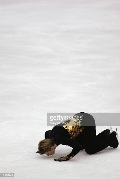 Alexei Yagudin of Russia kisses the ice after competing in the men's free program during the Salt Lake City Winter Olympic Games at the Salt Lake Ice...