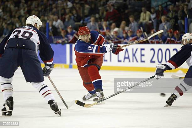 Alexei Yashin of Russia gets off a shot during the Salt Lake City Winter Olympic Games at the E Center in Salt Lake City Utah DIGITAL IMAGE Mandatory...