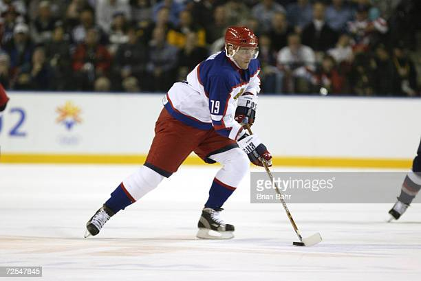 Alexei Yashin of Russia skates with the puck during the men's semifinals at the Salt Lake City Winter Olympic Games at the E Center in Salt Lake City...
