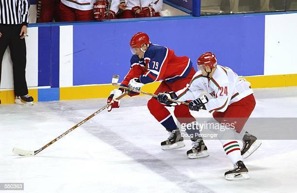 Alexie Yashin of Russia skates past Dmitry Dudik of Belarus during the Salt Lake City Winter Olympic Games at the E Center in Salt Lake City, Utah....