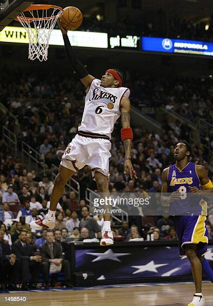 Allen Iverson of the Philadelphia 76''ers and the Eastern Conference team shoots the ball while defended by Kobe Bryant of the Los Angeles Lakers and...