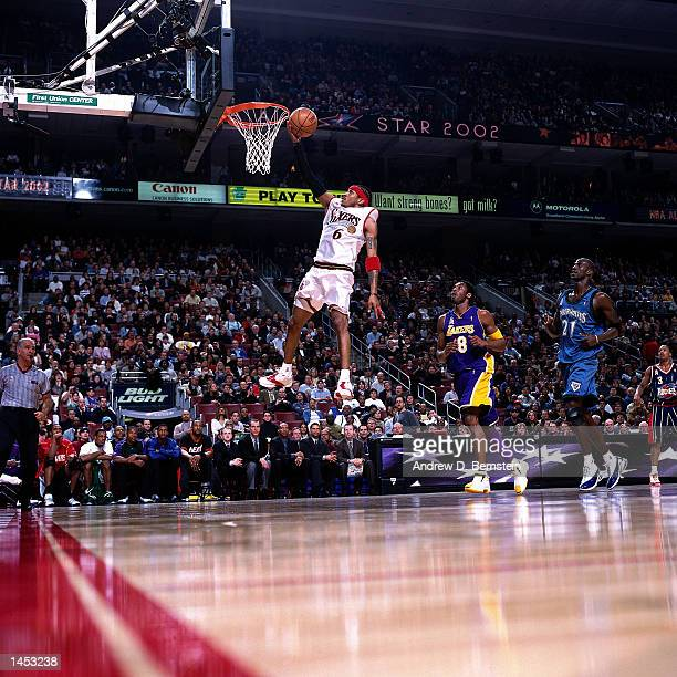 Allen Iverson of the Philadelphia 76''ers drives to the basket for a layup during the 2002 NBA All Star Game at the First Union Center in...