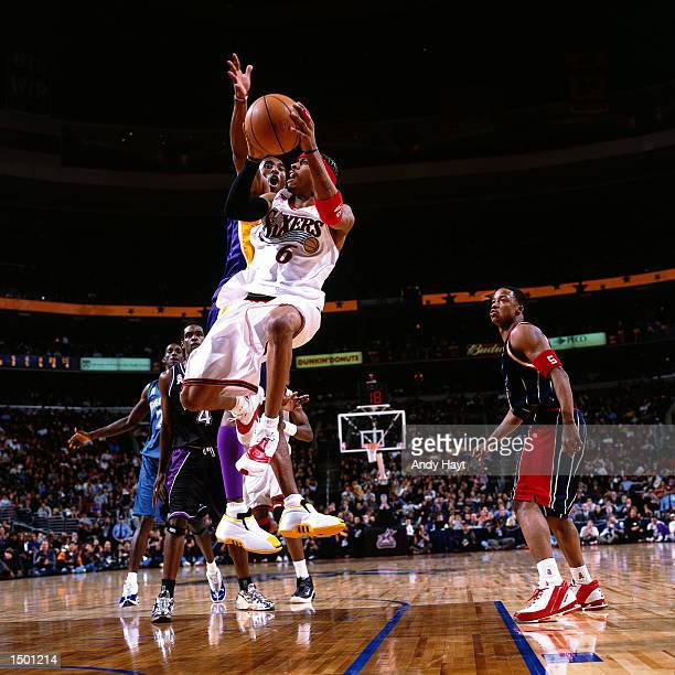 Allen Iverson of the Philadelphia 76ers drives to the basket against Kobe Bryant of the Los Angeles Lakers during the 2002 NBA All Star Game at the...