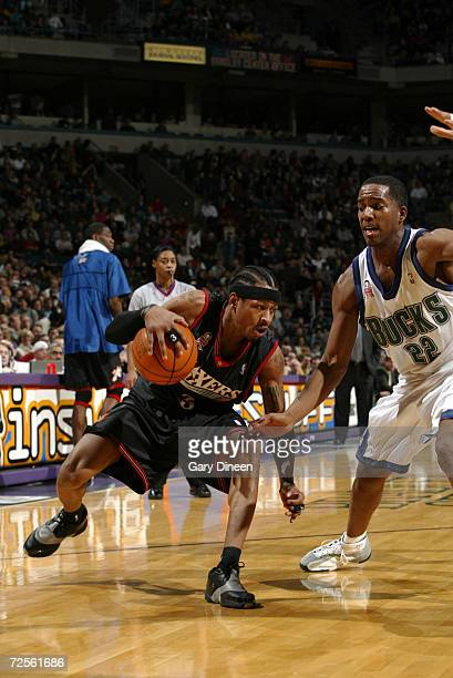 Allen Iverson of the Philadelphia 76ers goes to the basket against Michael Redd of the Milwaukee Bucks during their game at Bradley Center in...