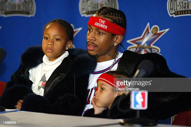 Allen Iverson of the Philadelphia 76ers meets with the media holding his children on his lap following the NBA AllStar 2002 game at the First Union...