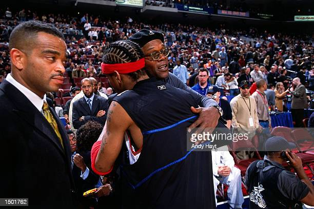 Allen Iverson of the Philadelphia 76ers shakes with Samuel Jackson before the start of the 2002 NBA All Star Game at the First Union Center in...