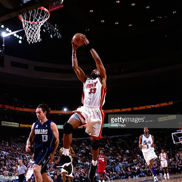 Alonzo Mourning of the Miami Heat drives to the basket for a dunk against Steve Nash of the Dallas Mavericks during the 2002 NBA All Star Game at the...