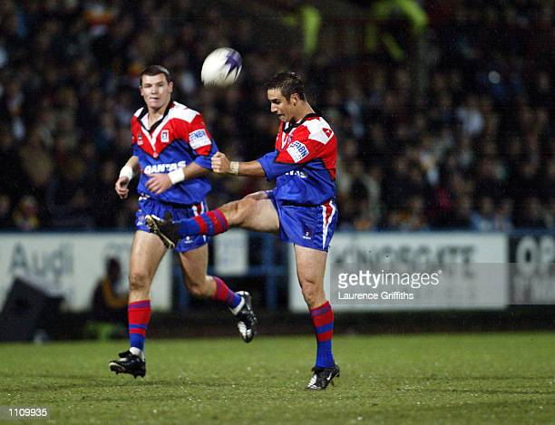 Andrew Johns of Newcastle Knights kicks the ball forward during the World Club Challenge match between Bradford Bulls and Newcastle Knights played at...
