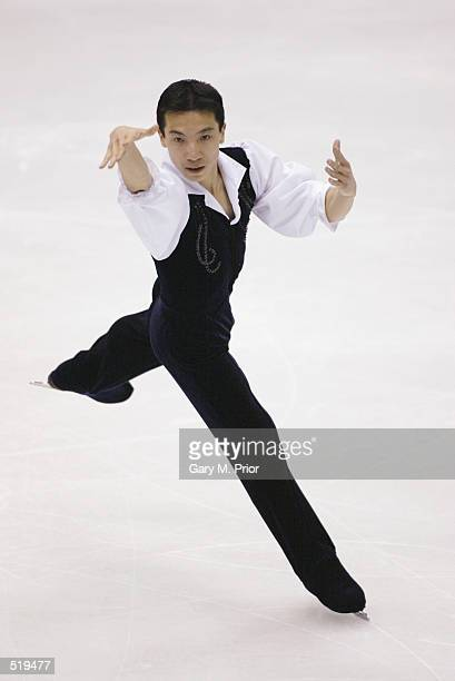 Anthony Liu of Australia competes in the men's free program during the Salt Lake City Winter Olympic Games at the Salt Lake Ice Center in Salt Lake...