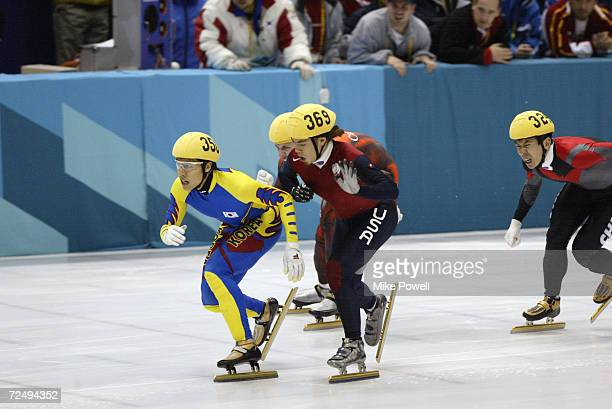 Apolo Anton Ohno of the USA is ''crosschecked'' by DongSung Kim of Korea in the Men's 1500m Short Track Speed Skating final during the Salt Lake City...