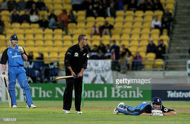 Ashley Giles of England has a laugh after nearly being run out as Andre Adams of New Zealand holds his bat during the New Zealand v England 2nd One...