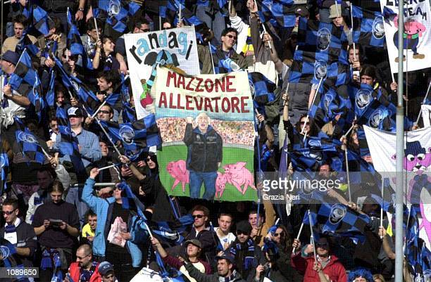 Atalanta fans show banners insulting Brescia coach Carlo Mazzone during the Serie A match between Atalanta and Brescia played at the Azzurri...