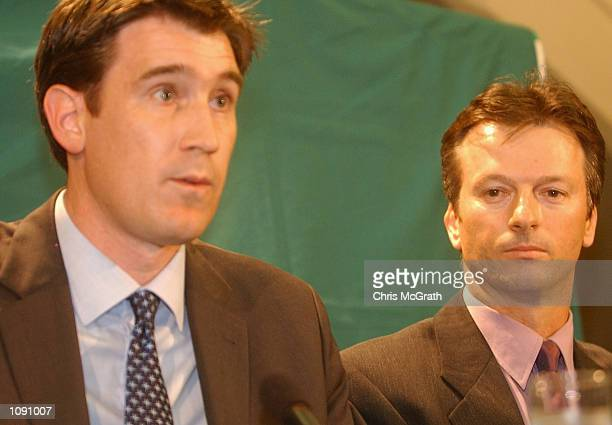 Australian cricket captain Steve Waugh listens as Australian Cricket Board Chief Executive James Sutherland announces that he was not selected for...