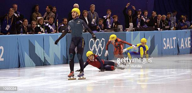 Australia's first ever Winter Gold medal winner Steven Bradbury crosses the line while America's Apolo Anton Ohno scrambles for the line to claim...