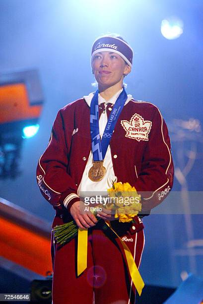 Beckie Scott of Canada receives her bronze medal in the women's crosscountry 5km free pursuit at the medal awards ceremony at the Olympic Medals...