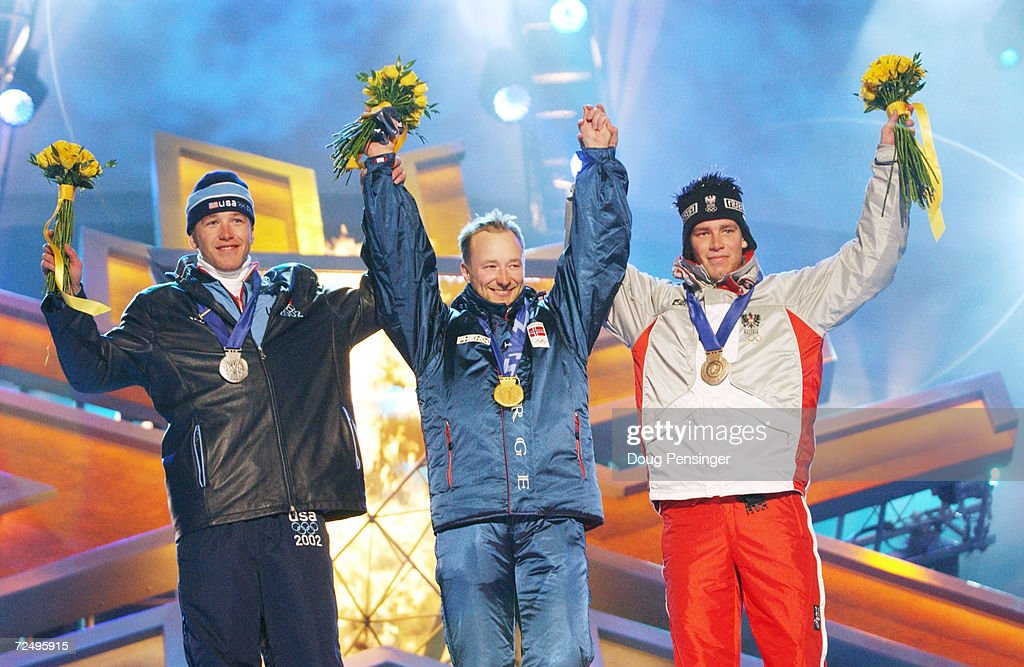 Bode Miller of USA, silver, Kjetil Andre Aamodt of Norway, gold, Benjamin Raich of Austria, bronze, receive their medals in the men's combined at the medal awards ceremony at the Olympic Medals Plaza during the Salt Lake City Winter Olympic Games in Salt Lake City, Utah. DIGITAL IMAGE. Mandatory Credit: Doug Pensinger/Getty Images