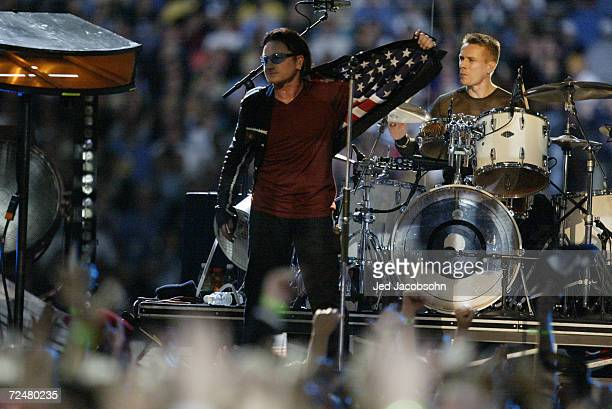 Bono and the band U2 perform during the halftime show at Superbowl XXXVI at the Superdome in New Orleans Louisiana The Patriots defeated the Rams...
