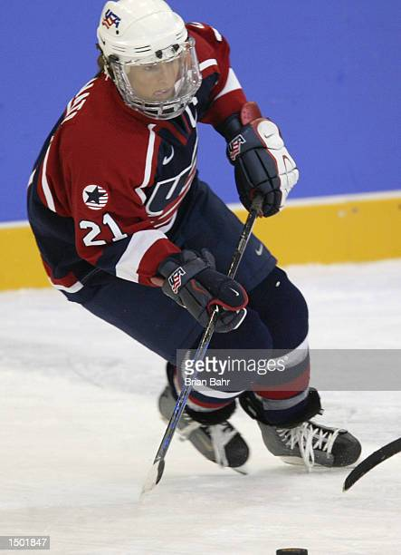 Cammi Granato of the USA handles the puck in the second period of a preliminary round game against China during the Salt Lake City 2002 Winter...