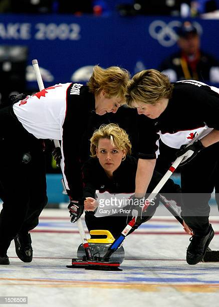 Canadian skip Kelly Law releases the stone on their way to winning the bronze medal during the Canada v USA women's curling bronze medal match during...