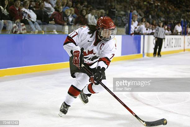 Cassie Campbell of Canada carries the puck against the USA during the womens ice hockey gold medal game at the Salt Lake City Winter Olympic at the E...