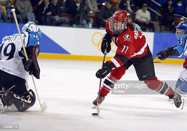 Cassie Campbell of Canada shoots and scores the last goal against Tuula Puputti of Finland during the Salt Lake City Winter Olympic Games at the E...