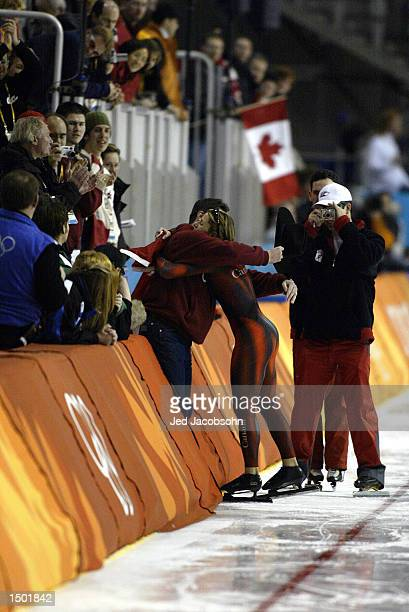 Catriona Lemay Doan of Canada hug her husband Bart Doan after winning the gold medal in the women's 500m speed skating event during the Salt Lake...