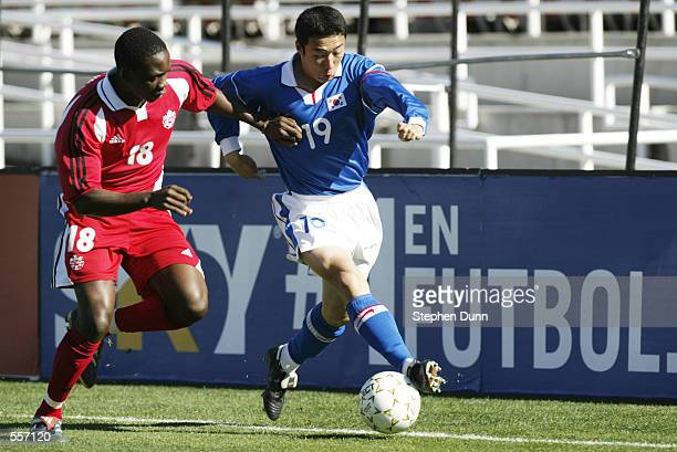 Cha DooLi from South Kore team blocks the ball from opposing team member Tam Nsaliwa of Canada in their CONCACAF Gold Cup third place match at the...