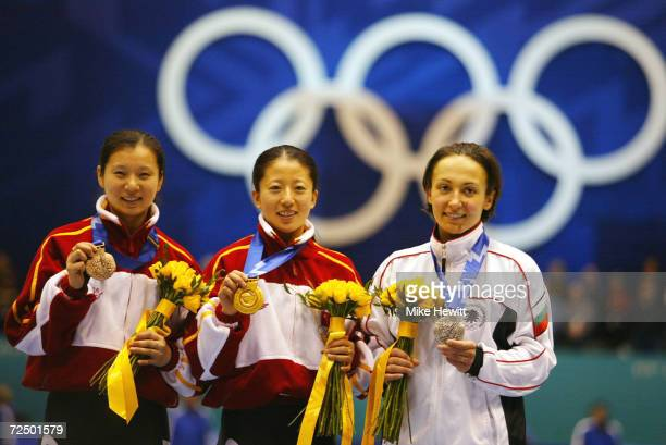 Chunlu Wang bronze of China Yang Yang gold of China and Evgenia Radanova silver of Bulgaria receive their medals for the women's 500m speed skating...
