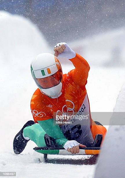 Clifton Wrottesley of Ireland celebrates finishing fourth in the men's skeleton during the Salt Lake City Winter Olympic Games at the Utah Olympic...