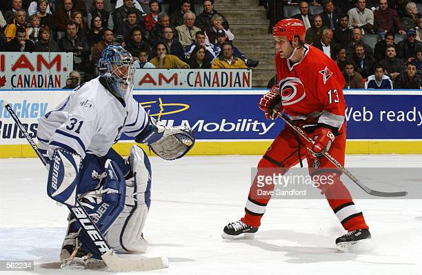 Curtis Joseph of the Toronto Maple Leafs defends against Bates Battaglia of the Carolina Hurricanes during the game at Air Canada Centre in Toronto...