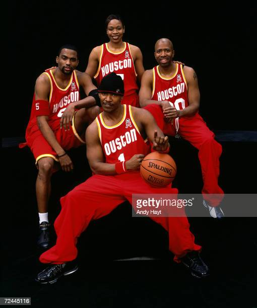 Cuttino Mobley Tina Thompson Kenny Smith and Jaime Foxx pose for a portrait before the 3 on 3 HoopItUp Celebrity Challenge during the 2002 NBA...