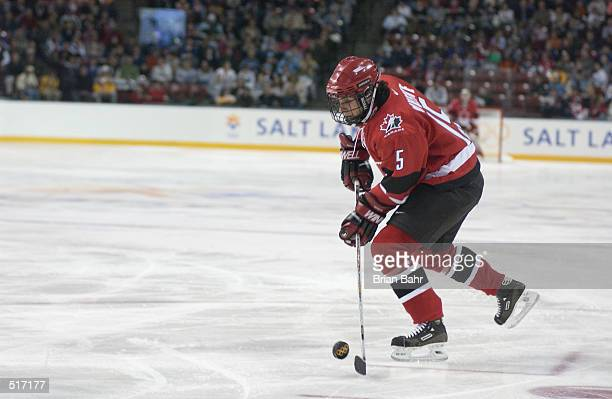 Danielle Goyette of Canada skates with the puck against Kazakhstan in the women's hockey preliminary round during the Salt Lake City Winter Olympic...