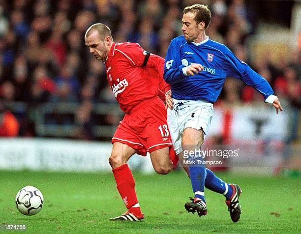 Danny Murphy of Liverpool holds off the challenge of Jamie Clapham of Ipswich during the FA Barclaycard Premiership match between Ipswich Town and...