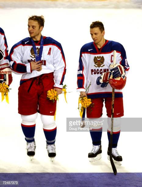 Darius Kasparaitis and Igor Larionov of Russia wear their bronze medal after 72 win in the mens ice hockey bronze medal game against Belarus at the...