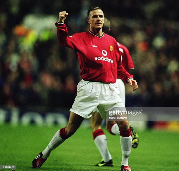 David Beckham of Manchester United celebrates his goal during the UEFA Champions League Second Stage Group A match against Nantes played at Old...