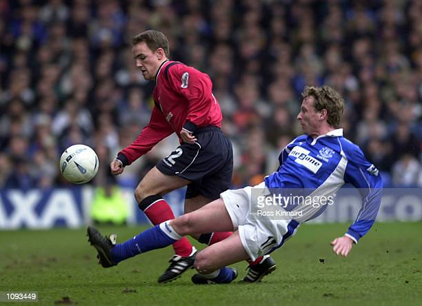 David Vaughan of Crewe gets past Scot Gemmill of Everton during the match between Everton and Crewe Alexandra in the AXA FA Cup Fifth Round at...