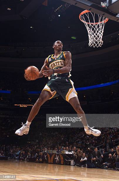 Desmond Mason of the Seattle SuperSonics attempts a dunk during the NBACOM Slam Dunk contest presented by RealOne during NBA AllStar 2002 Weekend in...