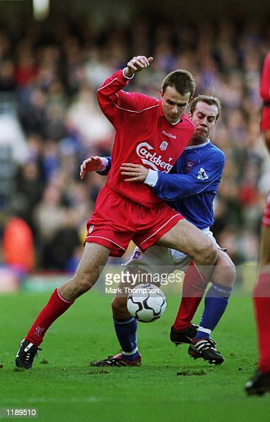 Dietmar Hamann of Liverpool holds the ball up against Jamie Clapham of Ipswich Town during the FA Barclaycard Premiership match played at Portman...