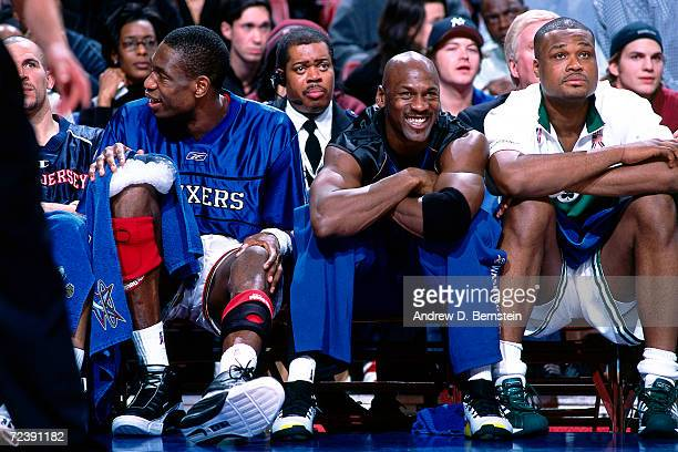 Dikembe Mutombo of the Philadelphia 76''ers Michael Jordan of the Washington Wizards and Paul Pierce of the Boston Celtics take a break on the bench...