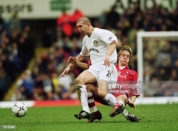 Dominic Matteo of Leeds United uses his strength to win the ball ahead of Mathias Svensson of Charlton Athletic during the FA Barclaycard Premiership...
