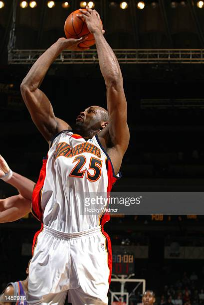Erick Dampier of the Golden State Warriors shoots the ball while playing against the Phoenix Suns at The Arena in Oakland California DIGITAL IMAGE...