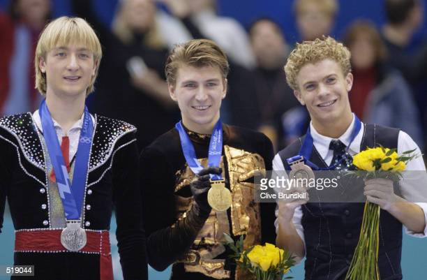Evgeni Plushenko of Russiasilver Alexei Yagudin of Russia gold Timothy Goebel of USA bronze receive their medals after competing in the men's free...