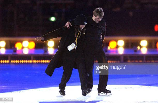 Former olympic skating champion Ilia Kulik and dancer Savion Glover perform during the Closing Ceremony of the Salt Lake City Winter Olympic Games at...