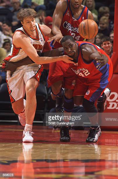 Forward Elton Brand of the Los Angeles Clippers and center Hanno Mottola of the Atlanta Hawks chase the ball during the NBA game at Philips Arena in...